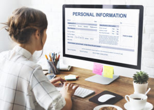 Woman on desktop entering personal information