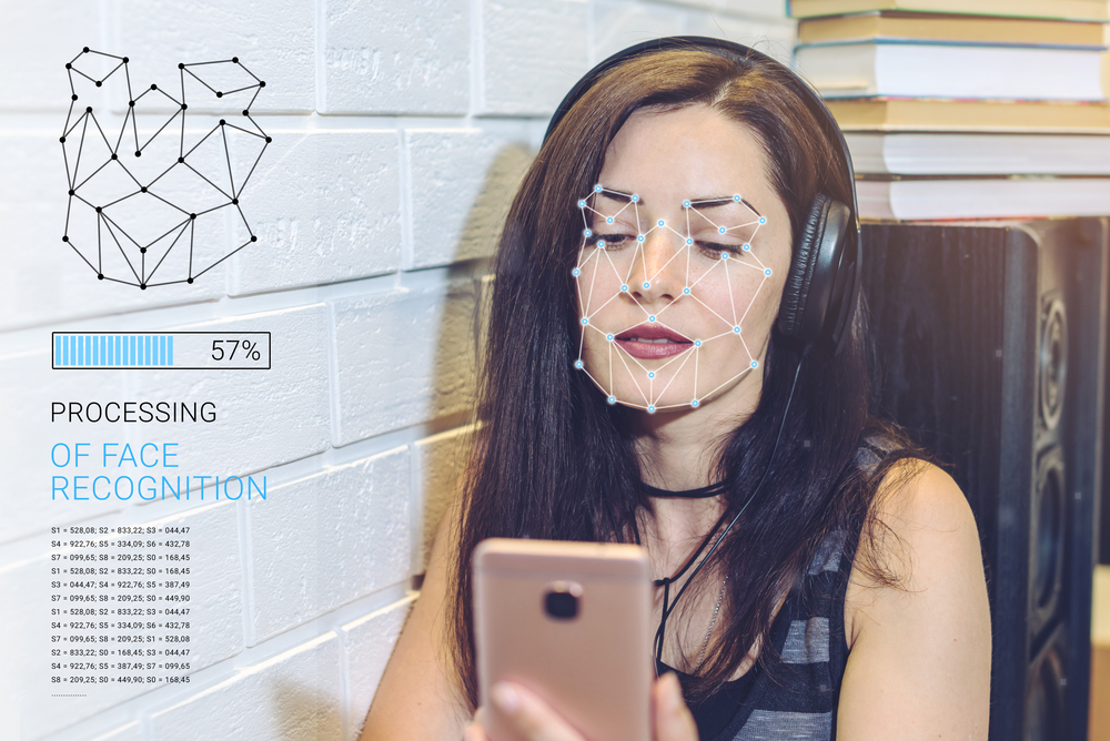 Facial recognition technology processing photo of woman