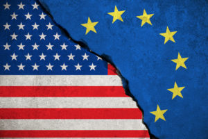 United States and European Union flags on walls crumbled into each other