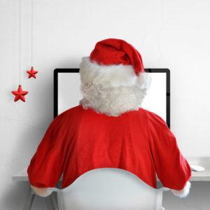 Santa sat at desktop working