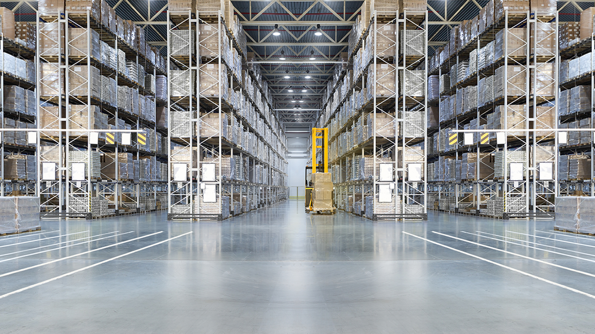 large silvery warehouse with forklift and shiny floor
